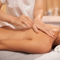 young-woman-getting-back-massage-spa-salon_1098-18128